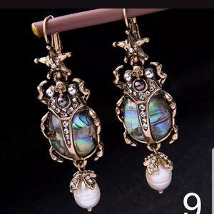 Lovely Egyptian style scarab  iridescent earrings